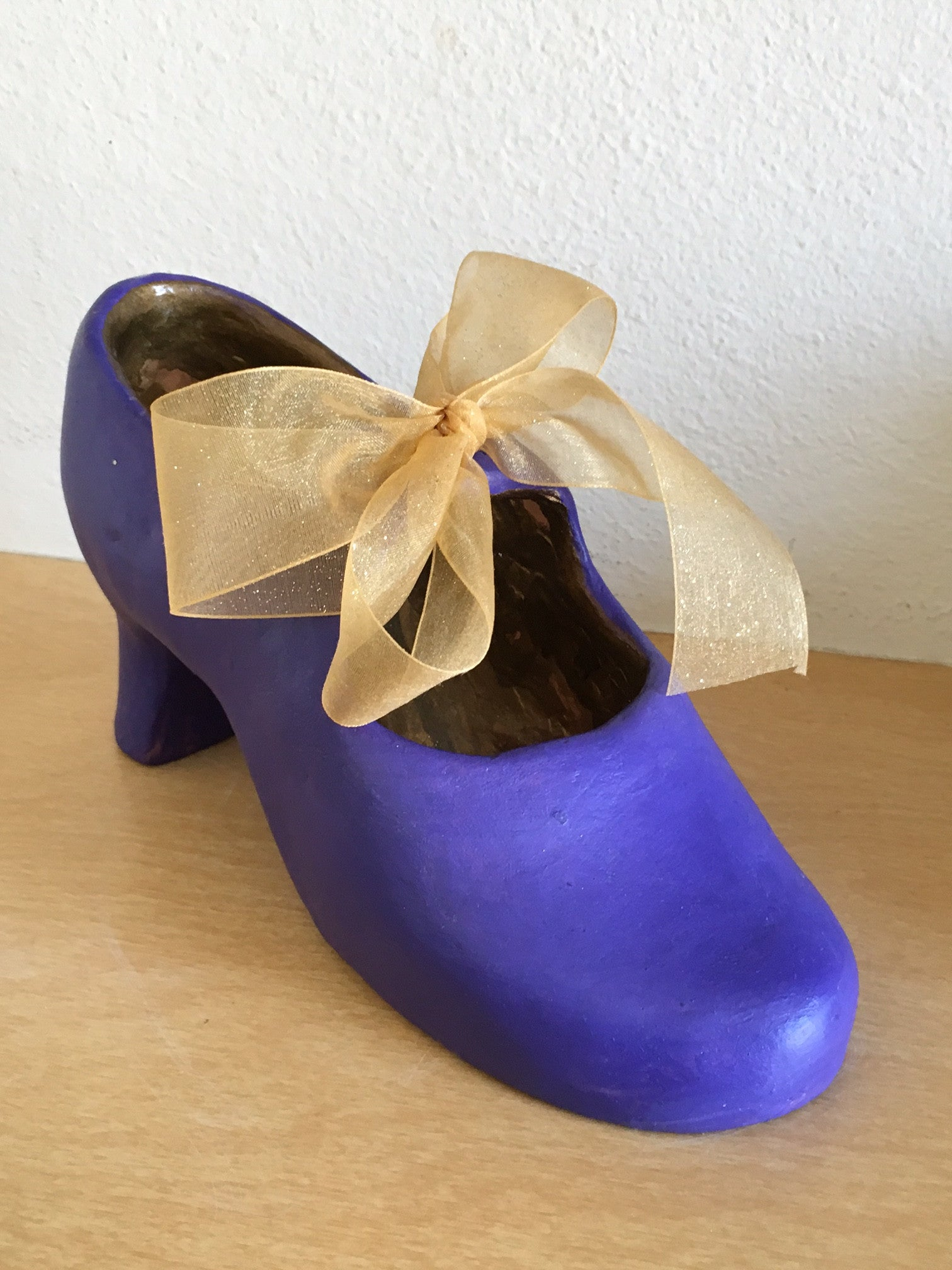 purple womens shoe clay statuette