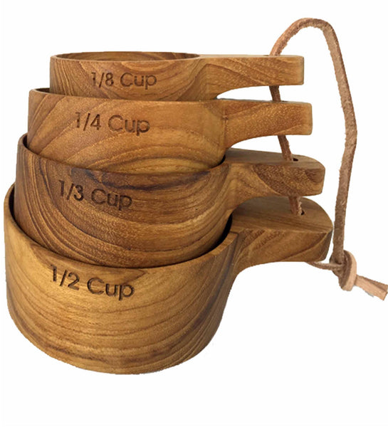 These high quality, wooden measuring cups are gorgeous! Handcrafted from sustainable teak wood. Set includes 1/8 cup, 1/4 cup, 1/3 cup and 1/2 cup measurements. Pair them with our teak measuring spoons to make a thoughtful gift.