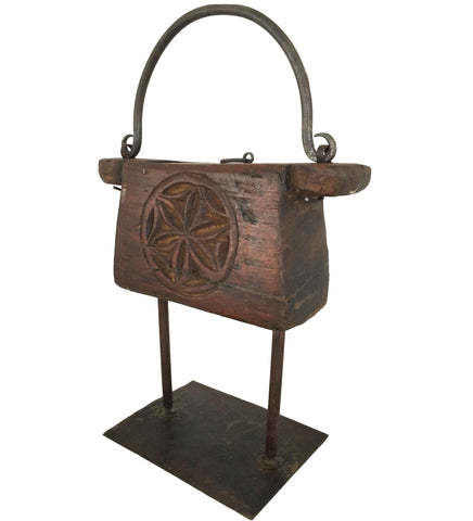 antique wooden tinder box made from heavy carved wood with a wrought iron handle