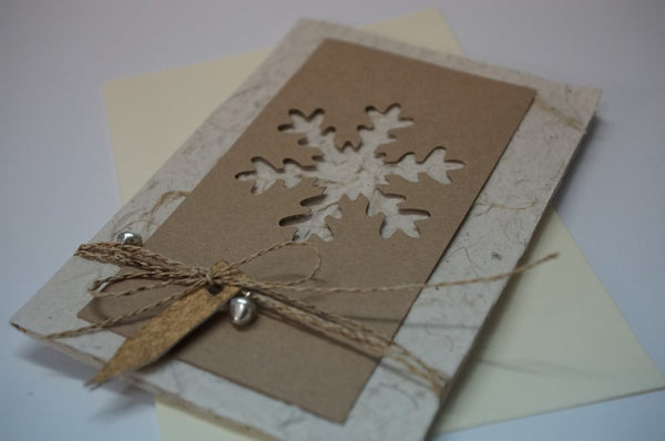 Snowflake and Bells Brown Close Up
