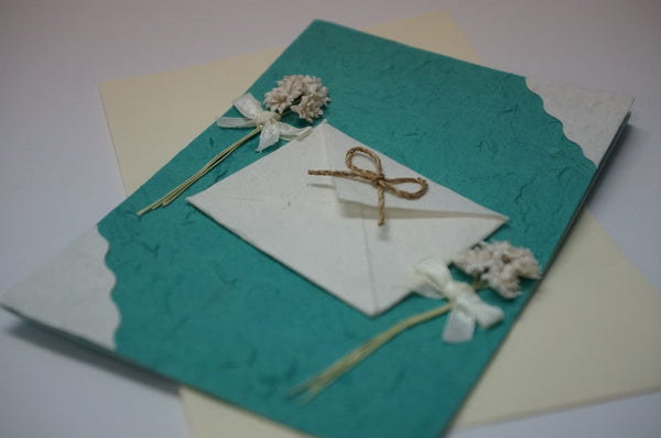 Green Card With White Envelope Close Up