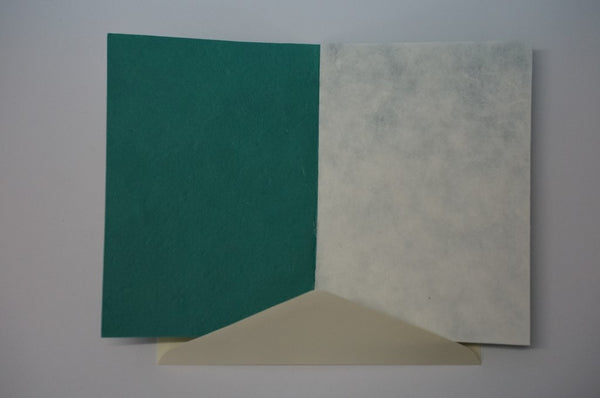 Green Card With White Envelope Inside