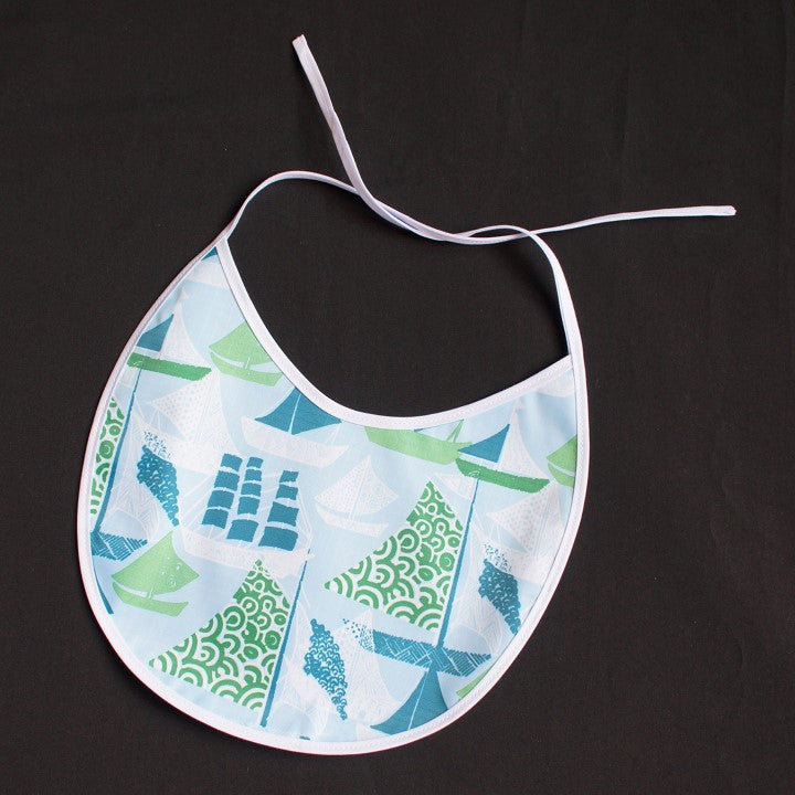 Baby Bib with Cute Ships Pattern on Light Blue Background and White Bordure