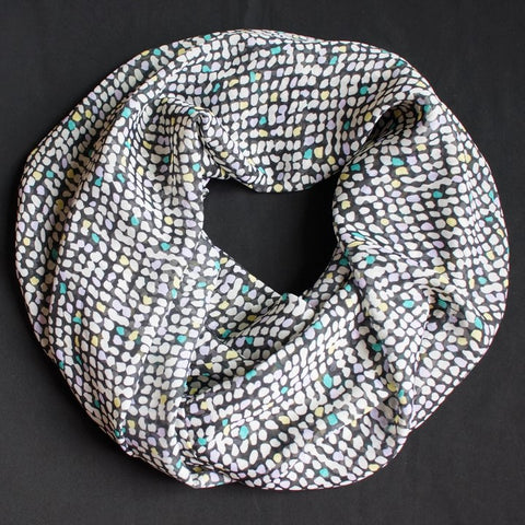 Dark blue scarf with dots in different colors
