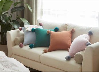 One touch of pom pom cushion