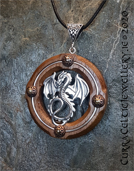 Silver Dragon on Iroko Hardwood with gold wire and copper accents.
