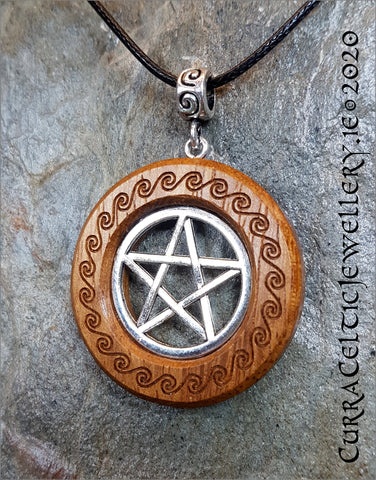 Silver Pentagram mounted in Iroko hardwood and engraved with Celtic spirals with matching bail.