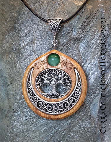 Oval Tree of Life symbol mounted in Iroko hardwood and embellished with a Green Aventurine bead.