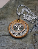 Oval Tree of Life symbol mounted in Iroko hardwood and embellished with a Tiger's Eye bead.