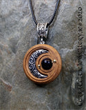 Silver Crescent Moon with spirals on Iroko with choice of Green Amazonite or Blue Goldstone bead.