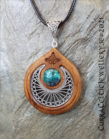 Featuring a fine silver filigree scallop with a cabochon of Sea Jasper mounted in an Iroko hardwood bezel.