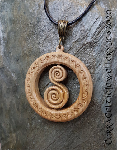 Double Spiral in Irish Oak. Pendant is double sided with matching Celtic weave bail in bronze.