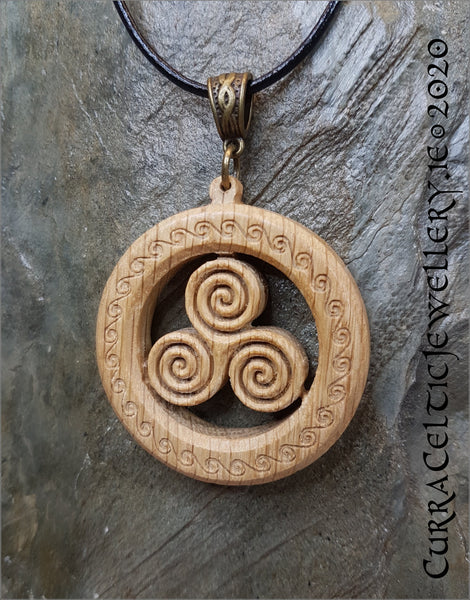 Trispiral in Irish Oak. Pendant is double sided with matching Celtic weave bail in bronze.