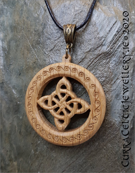 Crux symbol in Irish Oak. Pendant is double sided with matching Celtic weave bail in bronze.