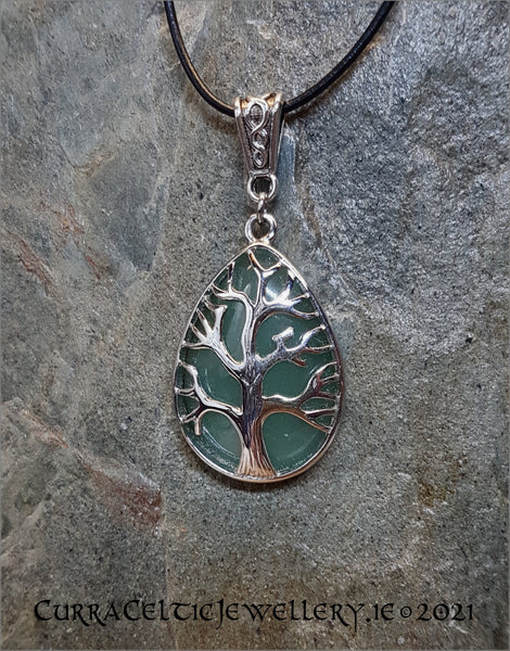 Aventurine gemstone mounted in a Tree of Life chrome bezel with Celtic weave bail.