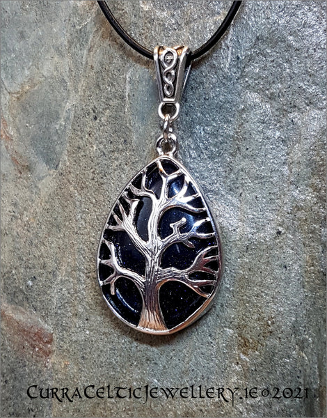 Blue Goldstone gemstone mounted in a Tree of Life chrome bezel with Celtic weave bail.