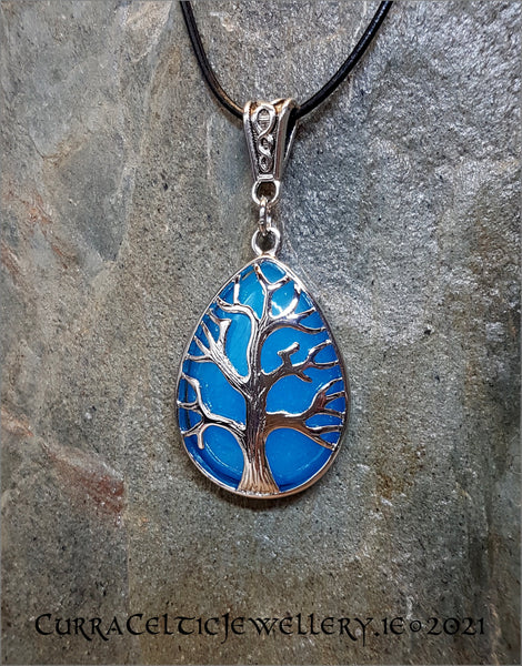 Blue Quartz gemstone (dyed) mounted in a Tree of Life chrome bezel with Celtic weave bail.