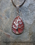 Pink Quartz gemstone mounted in a Tree of Life chrome bezel with Celtic weave bail.