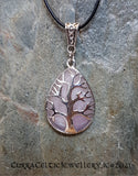Rose Quartz gemstone mounted in a Tree of Life chrome bezel with Celtic weave bail.
