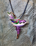Super colourful  hand-painted Bird Pendant, cold enameled & complete with Purple Spiral. The piece is also fitted with a clasp and can be worn as a Brooch!