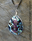 Pendant of Abalone Pāua Shell embellished here with a double spiral in purple hammered wire.