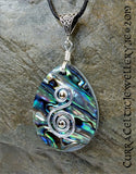 Pendant of Abalone Pāua Shell embellished here with a double spiral in silver wire.