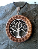 Tree of Life in silver or bronze on Iroko with carved Celtic spirals and knotwork bail in silver.