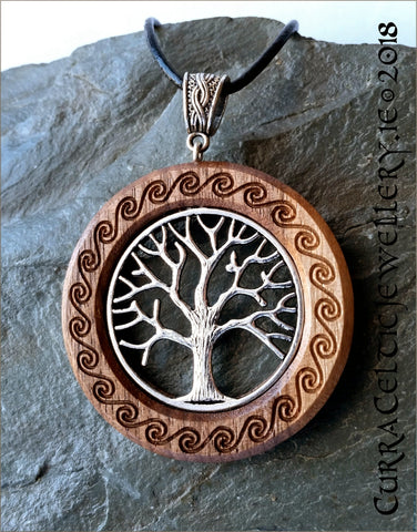 Tree of Life in silver on Iroko with carved Celtic spirals and knotwork bail in silver.