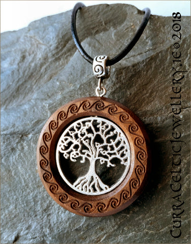 Tree of Life in silver on Walnut with celtic spirals and matching bail.