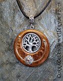 Tree of Life in silver or bronze on Iroko with carved Celtic spirals and wire accents.