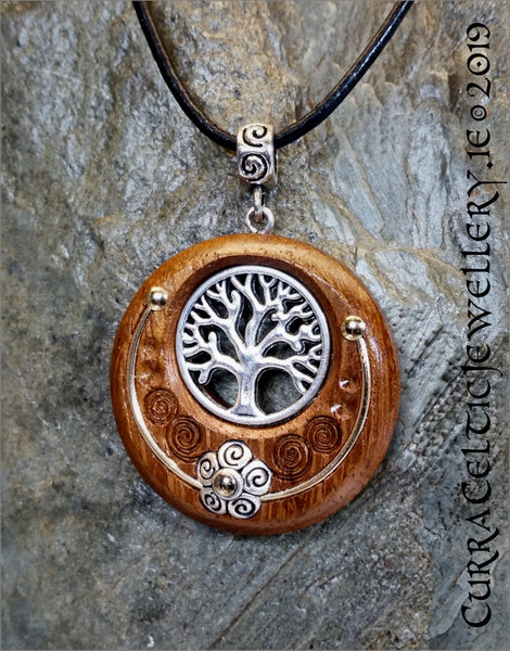 Tree of Life in silver on Iroko with carved Celtic spirals and wire accents.