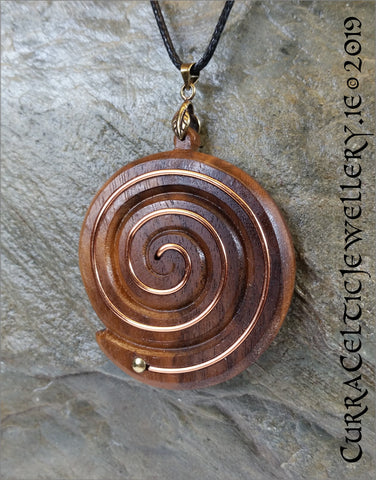 Rich tones in this black Walnut spiral inlaid by hand with copper wire for emphasis. Piece is inspired by the Newgrange spirals.