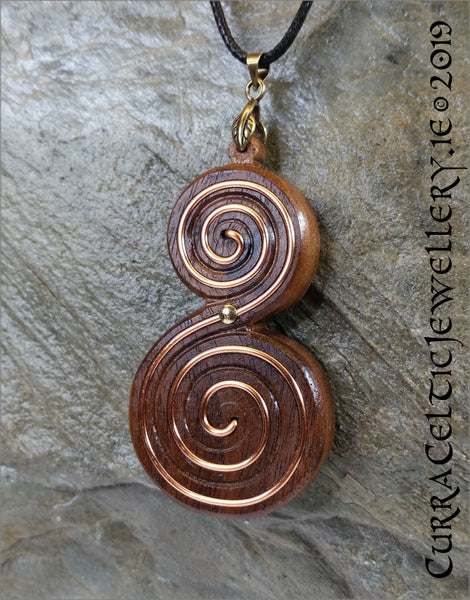 Rich tones in this black Walnut double spiral inlaid by hand with copper wire for emphasis. Piece is inspired by the Newgrange spirals.