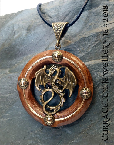 Bronze Dragon on Iroko Hardwood. with gold wire accents and matching bronze bail.