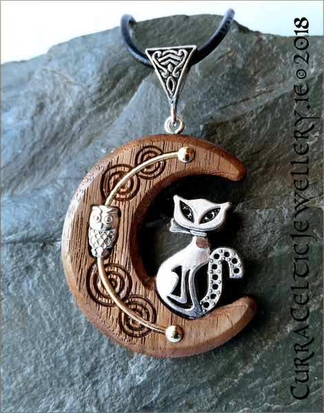 Owl n' Pussy Cat on black Walnut with gold wire accents and silver bail