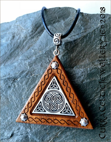 Black Walnut with fine pewter inlay featuring Triskele and Celtic knotwork.