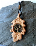 Tree of Life (yggdrasil) in silver or bronze on Irish Oak with handmade spiral bail.