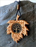 Tree of Life symbol (yggdrasil)  in silver or bronze on Irish Oak with handmade spiral bail.