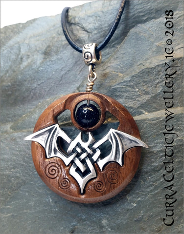 Celtic Bat in fine pewter on Black Walnut with spiral bail and choice of 2 gemstone beads.