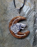 Dire Wolf in silver on Black Walnut with silver wire accent and spiral bail.