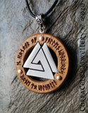 Norse Valknut symbol (fallen warrior knot) in pewter mounted in a bezel of Iroko hardwood with copper highlights. Engraved with Elder Runes (see below for translation)