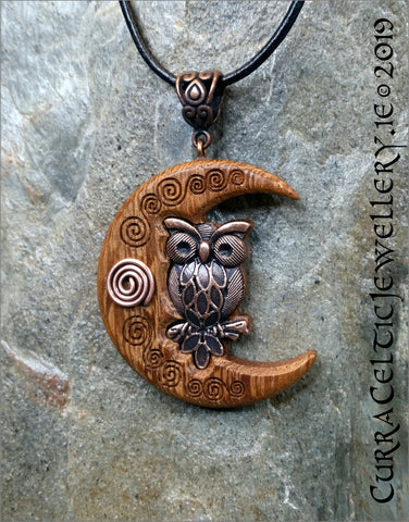 Antique style copper Owl on Crescent Moon of Iroko hardwood with antiqued copper wire spiral.