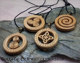 Single Spiral in Irish Oak. Pendant is double sided with matching Celtic weave bail in bronze.