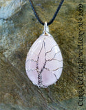 Rose Quartz gemstone wire wrapped with Tree of Life symbol in silver plated wire.