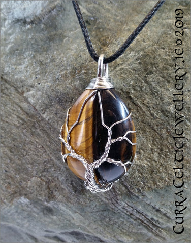 Tiger's Eye gemstone wire wrapped with Tree of Life symbol in silver plated wire.