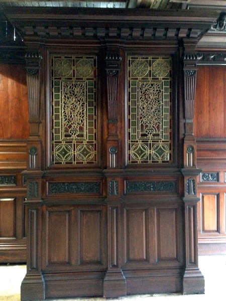 Victorian mahogany panelled room with stained glass