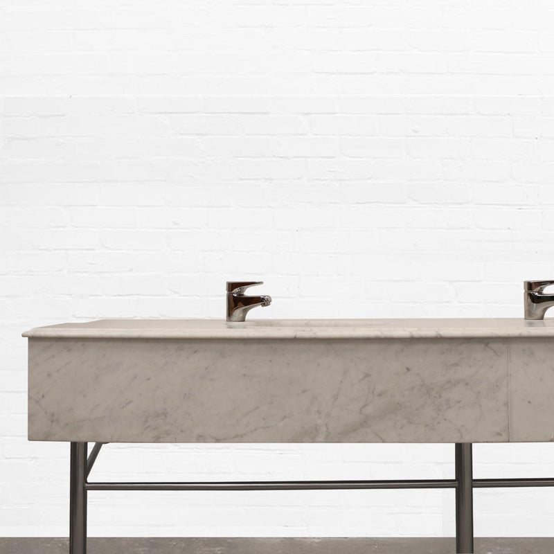 white carrara marble sink unit