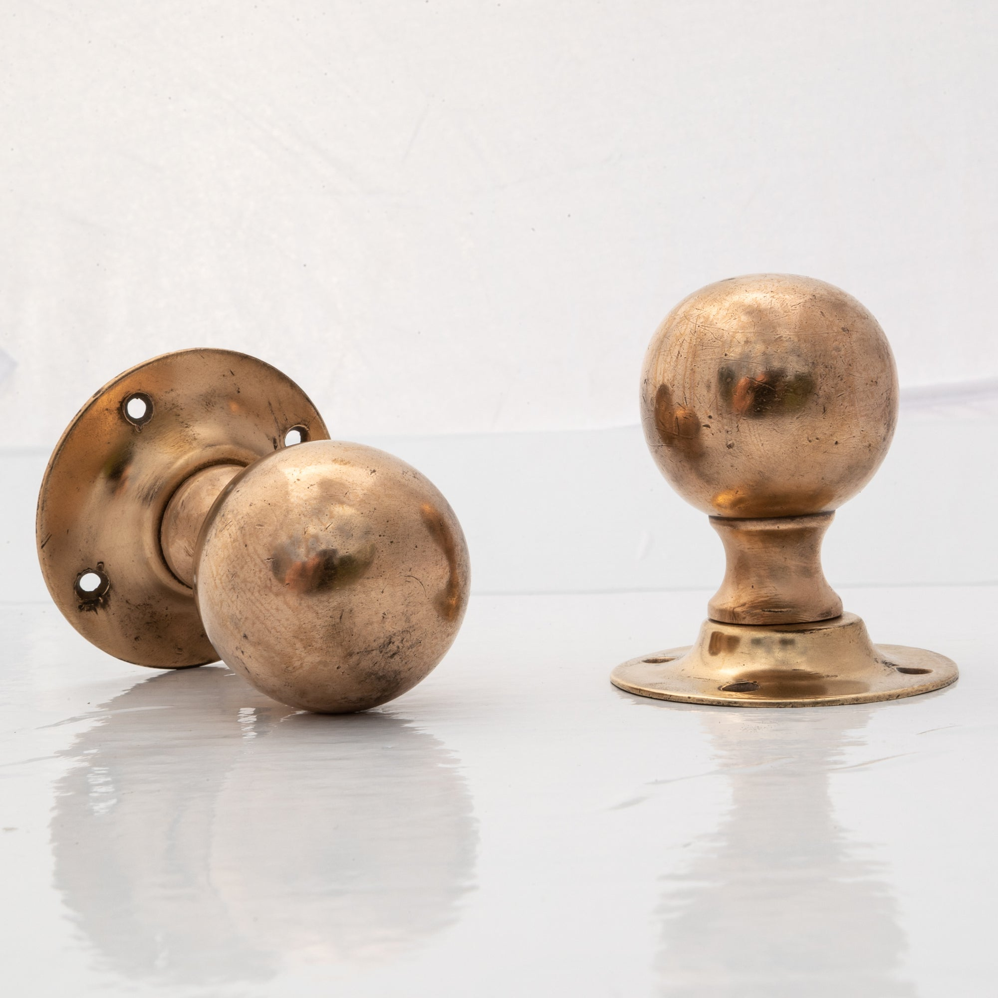 Pair of Antique Rose Brass Door Knobs | The Architectural Forum