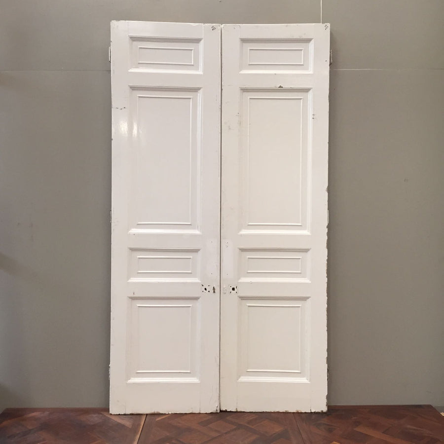 A pair of Victorian dividing doors in pine. These attractive original doors feature a recessed eight panel design, and are being sold in their current painted state. These double doors would make a wonderful dividing feature between reception rooms