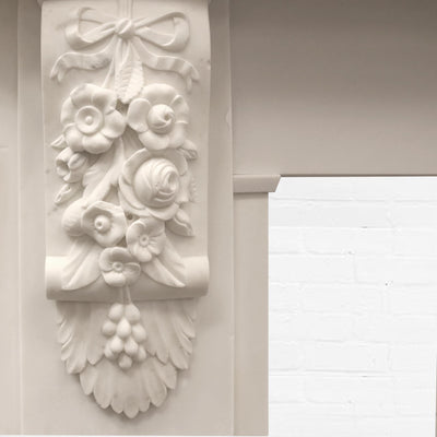 An original Victorian statury marble fire surround with highly ornate carved decoration to the lintel and corbels